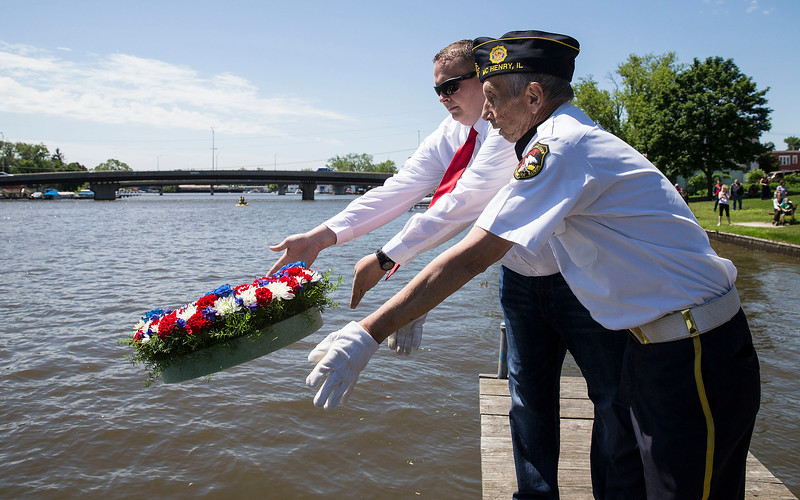 McHenry Mayor Wayne Jett, left, and Senior Vice Commander Rich Young with the American Legion Post 491 toss a wreath into the Fox River in honor of Navy Veterans at Weber Park on Memorial Day Monday, May 29, 2017 in McHenry. John Konstantaras photo for the Northwest Herald