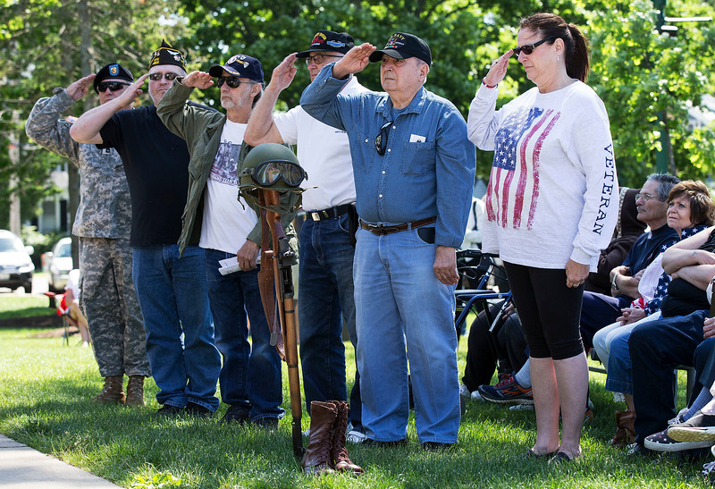 Veterans salute after assembling a Fallen Soldier Battle Cross during the Memorial Day ceremony at Veterans Memorial Park on Monday, May 29, 2017 in McHenry. John Konstantaras photo for the Northwest Herald