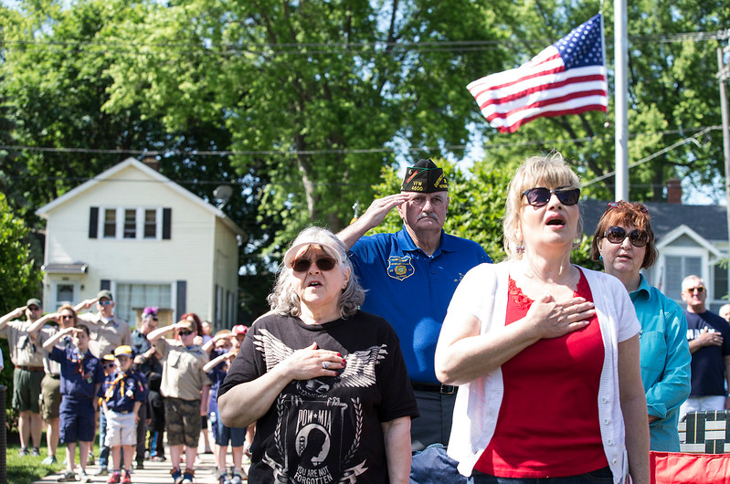 Marine veteran Ray Rigsby, center from McHenry, salutes as Jonathon Wills, not pictured, sings the National Anthem during the Memorial Day ceremony at Veterans Memorial Park on Monday, May 29, 2017 in McHenry. John Konstantaras photo for the Northwest Herald
