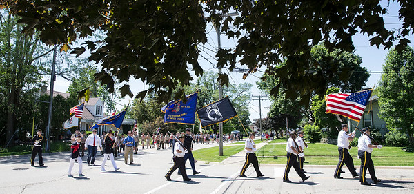 A parade for Memorial day turns off Riverside Drive onto Washington Boulevard as the head to St. Patrick's Parish Cemetery on Monday, May 29, 2017 in McHenry. John Konstantaras photo for the Northwest Herald