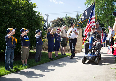 Cub Scouts salute as members of the Polish  Legion of American Veterans Post 188 color guard arrive at the Memorial Day ceremony at Veterans Memorial Park on Monday, May 29, 2017 in McHenry. John Konstantaras photo for the Northwest Herald