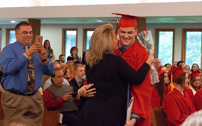 Mike Greene - For Shaw Media  Nathaniel Ayers receives an embrace after getting his diploma during graduation ceremonies for Faith Lutheran High School Saturday, May 20, 2017 at Prince-Peace Lutheran Church in Crystal Lake.