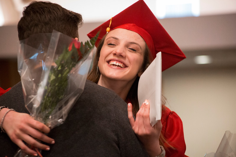 Mike Greene - For Shaw Media  Victoria Budek gets a hug after receiving her diploma during graduation ceremonies for Faith Lutheran High School Saturday, May 20, 2017 at Prince-Peace Lutheran Church in Crystal Lake.
