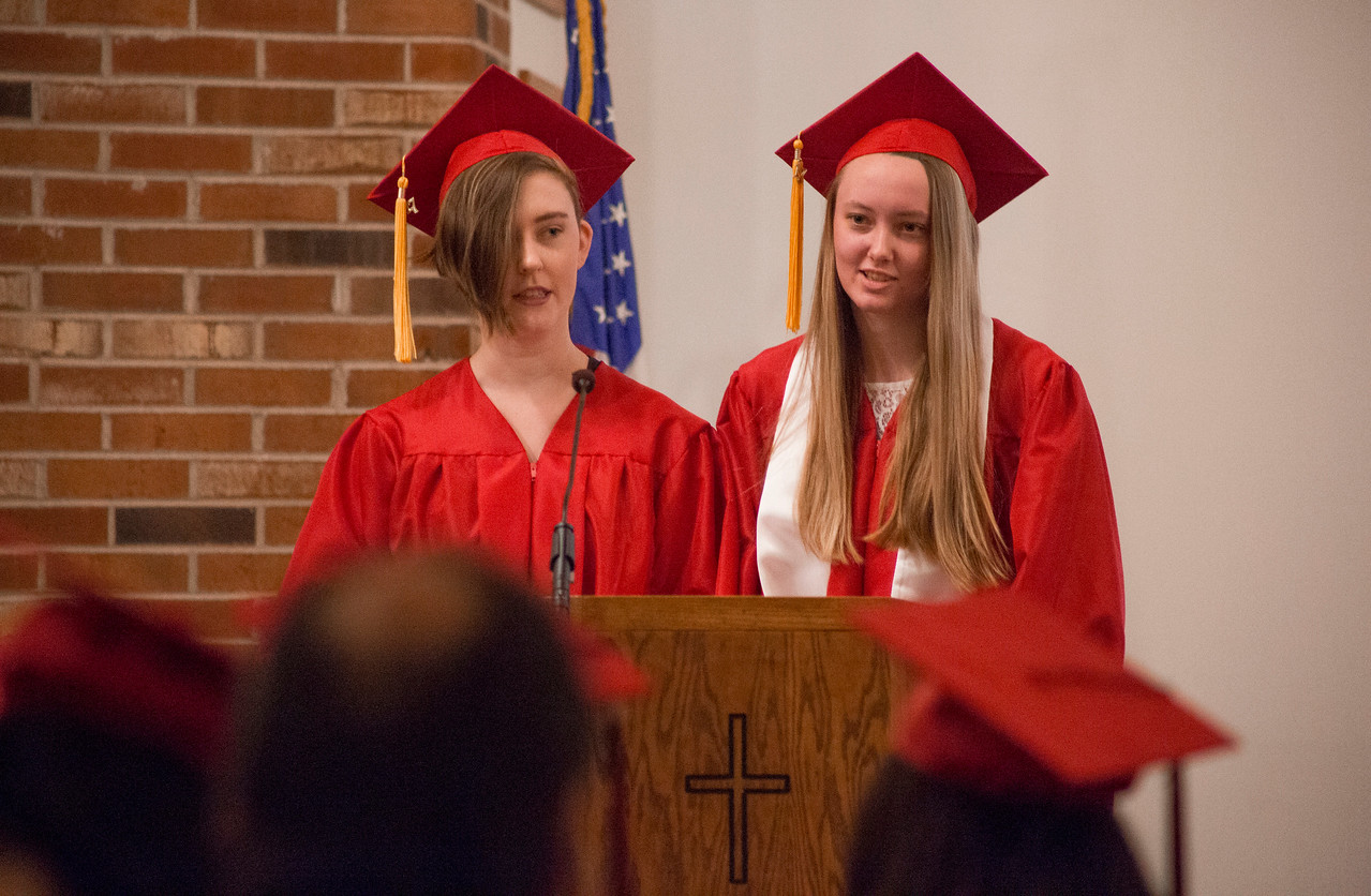 Mike Greene - For Shaw Media  Kate McNicholas, left, and Natalie Borman give the introit for graduation during graduation ceremonies for Faith Lutheran High School Saturday, May 20, 2017 at Prince-Peace Lutheran Church in Crystal Lake.