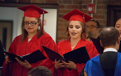 Mike Greene - For Shaw Media  Graduating seniors Haley Lange, left, and Terry Jo Macygin sing with the chior during graduation ceremonies for Faith Lutheran High School Saturday, May 20, 2017 at Prince-Peace Lutheran Church in Crystal Lake.