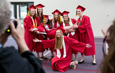 Mike Greene - For Shaw Media  A group of graduating seniors pose for a photo before the start of graduation ceremonies for Faith Lutheran High School Saturday, May 20, 2017 at Prince-Peace Lutheran Church in Crystal Lake.