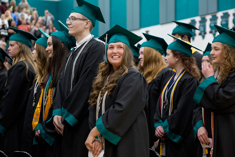 Mike Greene - For Shaw Media  A student looks up into the crowd during graduation ceremonies for Woodstock North High School Saturday, May 20, 2017 in Woodstock .