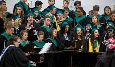"Mike Greene - For Shaw Media  Graduating seniors join the varsity choir in a presentation of the song ""Long Live"" during graduation ceremonies for Woodstock North High School Saturday, May 20, 2017 in Woodstock ."