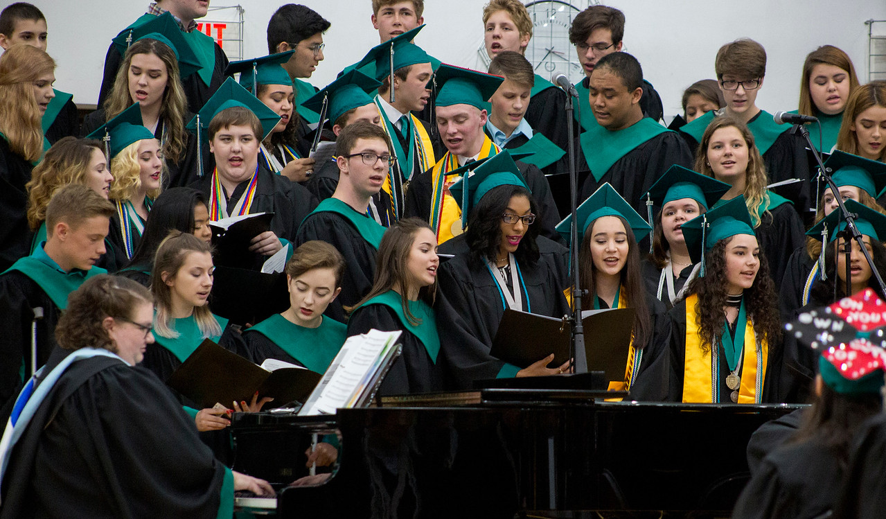 """Mike Greene - For Shaw Media  Graduating seniors join the varsity choir in a presentation of the song """"Long Live"""" during graduation ceremonies for Woodstock North High School Saturday, May 20, 2017 in Woodstock ."""
