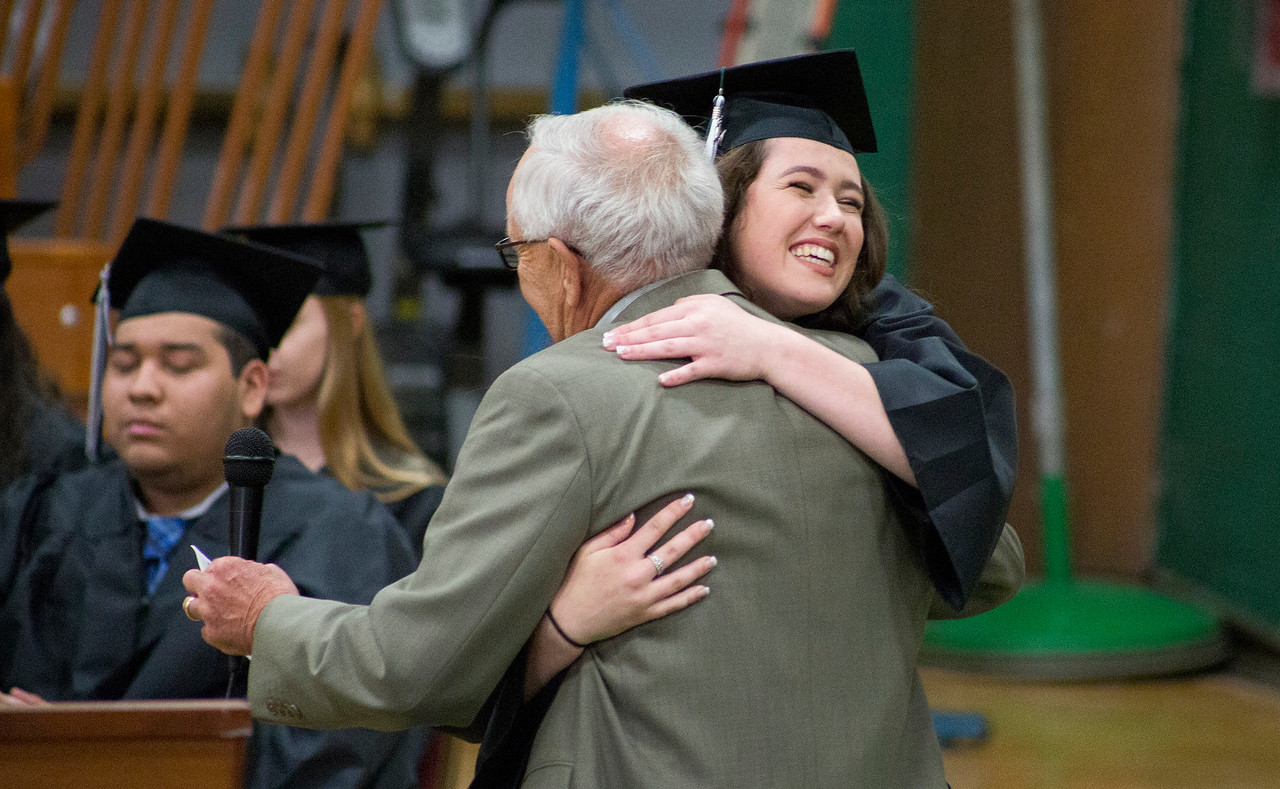 Mike Greene - For Shaw Media  Emily Webber receives a hug after being recognized for receiving a scholarship during graduation ceremonies for Alden-Hebron High School Sunday, May 21, 2017 in Hebron.