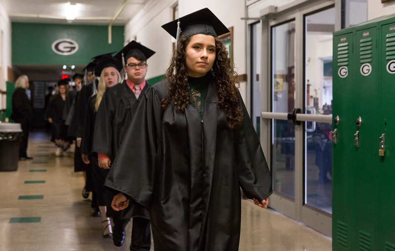 Mike Greene - For Shaw Media  Marisol Abrego leads her classmates through the hallways before the start of  graduation ceremonies for Alden-Hebron High School Sunday, May 21, 2017 in Hebron.