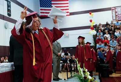 Matthew Briggs gestures to the crowd after accepting his diploma during commencement ceremonies at Richmond-Burton High School on Sunday, May 21, 2017 in Richmond.  John Konstantaras photo for the Northwest Herald
