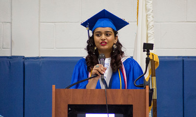 Mike Greene - For Shaw Media  Class Co-President Pooja Patel speaks during graduation ceremonies for Woodstock High School Sunday, May 21, 2017 in Woodstock.