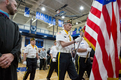 Mike Greene - For Shaw Media  Members of VFW Post 5040 present the colors during graduation ceremonies for Woodstock High School Sunday, May 21, 2017 in Woodstock.