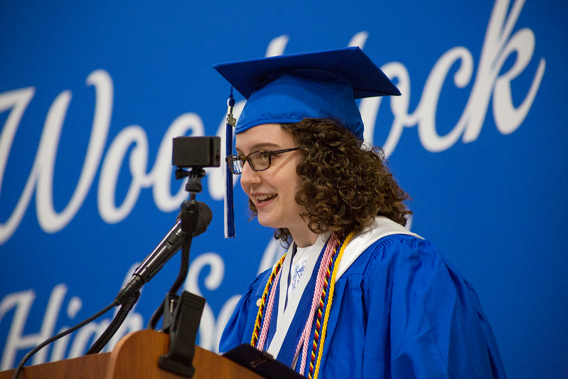 Mike Greene - For Shaw Media  Kelly Read gives the senior reflection address during graduation ceremonies for Woodstock High School Sunday, May 21, 2017 in Woodstock.