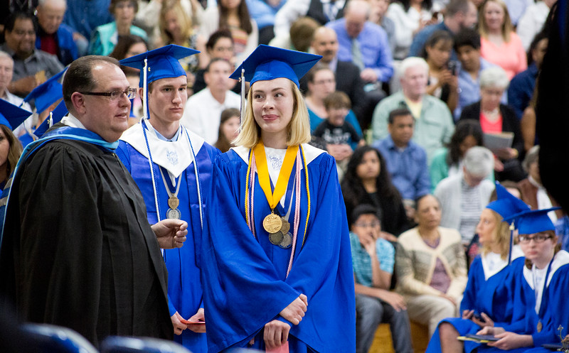 Mike Greene - For Shaw Media  Class Salutatorian Kathryn Dawdy prepares to have her name called during graduation ceremonies for Woodstock High School Sunday, May 21, 2017 in Woodstock.