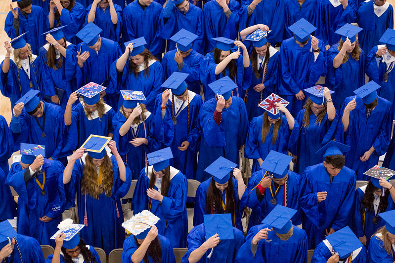 Mike Greene - For Shaw Media  Students switch their tassels to the left during graduation ceremonies for Woodstock High School Sunday, May 21, 2017 in Woodstock.