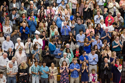 Mike Greene - For Shaw Media  Members of the audience clap for the graduates during graduation ceremonies for Woodstock High School Sunday, May 21, 2017 in Woodstock.