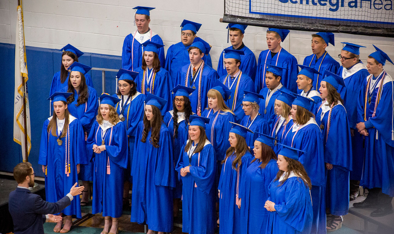 Mike Greene - For Shaw Media  Members of the Senior Choir perform during graduation ceremonies for Woodstock High School Sunday, May 21, 2017 in Woodstock.