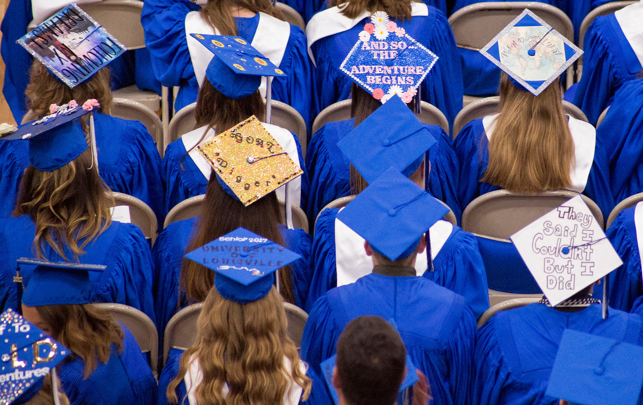 Mike Greene - For Shaw Media  Rows of decorated caps can be seen during graduation ceremonies for Woodstock High School Sunday, May 21, 2017 in Woodstock.