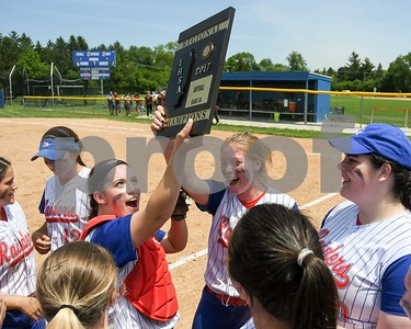 Glenbard South teammates Allie Sims (17) and catcher Sarah Marsden (20) hold up the regional title plaque after beating Wheaton Academy 6-1 May 27 in the Class 3A softball regional final at Glenbard South High School. David Toney for Shaw Media