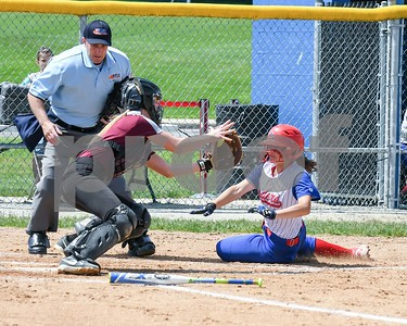 Glenbard South Kate Mora (9) gets tagged out by Wheaton Academy Haleigh Van Wagner (4) in the first inning May 27 in the Class 3A softball regional final at Glenbard South High School. David Toney for Shaw Media