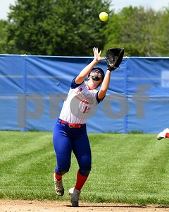 Glenbard South Bailee Flanagan (13) catches a pop up in the third inning May 27 in the Class 3A softball regional final against Wheaton Academy at Glenbard South High School. David Toney for Shaw Media