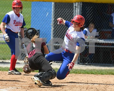 Glenbard South Bailee Flanagan (13) gets tagged out by Wheaton Academy Haleigh Van Wagner (4) in the first inning May 27 in the Class 3A softball regional final at Glenbard South High School. David Toney for Shaw Media