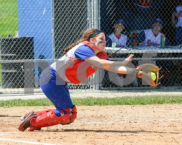 Glenbard South catcher Sarah Marsden (20) catches a pop-up in the third inning May 27 in the Class 3A softball regional final against Wheaton Academy at Glenbard South High School. David Toney for Shaw Media