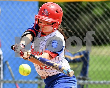 Glenbard South Mady Carli (12) gets a base hit in the sixth inning against Wheaton Academy May 27 in the Class 3A softball regional final at Glenbard South High School. David Toney for Shaw Media