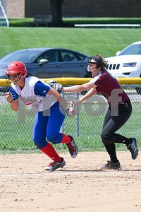 Glenbard South Jocelyn Leerschen (25) gets caught between bases as Wheaton Academy Julia Palmer (7) tags her May 27 in the Class 3A softball regional final at Glenbard South High School. David Toney for Shaw Media