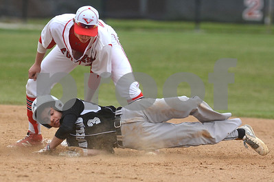 Yorkville senior Brendon Reifsteck puts the tag on Kaneland's Joey Brandonisio during their game May 9 at Yorkville High School. Mark Busch - mbusch@shawmedia.com