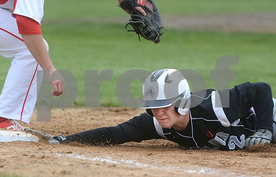 Kaneland senior Preston Havis dives safely back into first on a pickoff attempt during their game against Yorkville May 9 at Yorkville High School. Mark Busch - mbusch@shawmedia.com