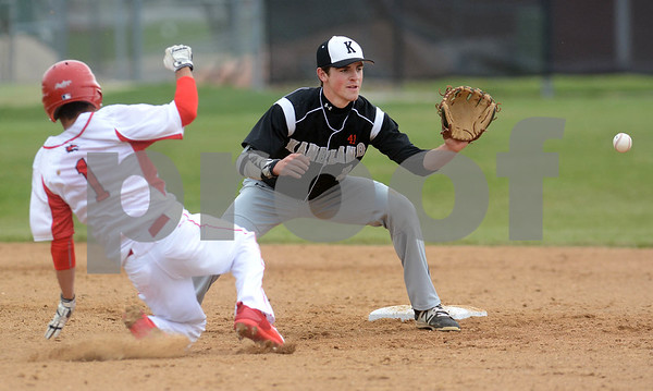Kaneland senior Jack Marshall takes the throw as Yorkville's Luis Rodriguez slides into second during their game May 9 at Yorkville High School. Mark Busch - mbusch@shawmedia.com
