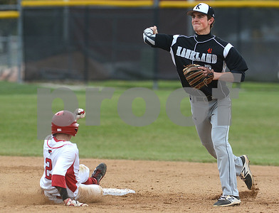 Kaneland senior Jack Marshall turns a double play as Yorkville's Lucas Farren slides in during their game May 9 at Yorkville High School. Mark Busch - mbusch@shawmedia.com