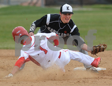 Kaneland senior Jack Marshall tries to tag Yorkville's Luis Rodriguez during their game May 9 at Yorkville High School. Mark Busch - mbusch@shawmedia.com