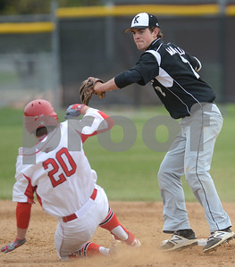 Kaneland senior Jack Marshall tries to turn two as Yorkville's Brendon Reifsteck attempts to break it up during their game May 9 at Yorkville High School. Mark Busch - mbusch@shawmedia.com