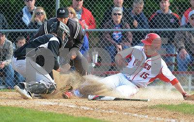 Yorkville junior Jonathon Jungr tries to score on a squeeze bunt but is tagged out by Kaneland's Josh Norman during their game May 9 at Yorkville High School. Mark Busch - mbusch@shawmedia.com