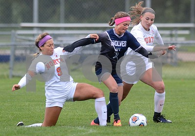 Oswego East sophomore Brooke Lipscomb splits two Naperville North defenders during their Class 3A Regional final game May 19 at Oswego High School. Mark Busch - mbusch@shawmedia.com