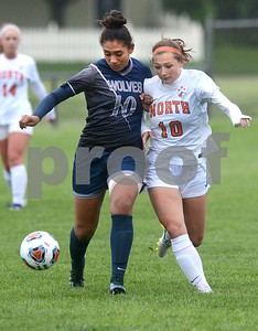 Oswego East senior Jasmine Ruiz and Naperville North's Katelynn Buescher race to the ball during their Class 3A Regional final game May 19 at Oswego High School. Mark Busch - mbusch@shawmedia.com