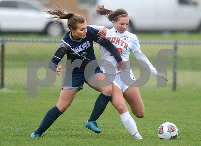 Oswego East sophomore Sydney Conway pushes Naperville North's Katelynn Buescher off the ball during their Class 3A Regional final game May 19 at Oswego High School. Mark Busch - mbusch@shawmedia.com
