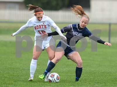 Oswego East senior Taylor Peck fights for the ball with Naperville North's Katelynn Buescher during their Class 3A Regional final game May 19 at Oswego High School. Mark Busch - mbusch@shawmedia.com