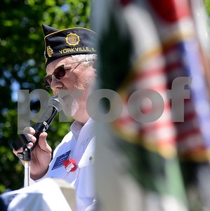 Yorkville American Legion Post 489 commander Tim Conrarady shares his thoughts with the crowd during the annual Memorial Day Service at Town Square Park in Yorkville on Monday, May 29, 2017. Steven Buyansky for Shaw Media