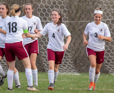 Prairie Ridge teammates celebrate Chelsea Gale's (4) second half goal Tuesday, May 1, 2018 in Prairie Grove. Prairie Ridge goes on to win 2-0 over Jacobs. KKoontz- For Shaw Media
