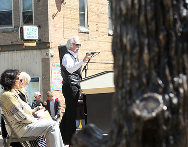 Candace H. Johnson-For Shaw Media Artist Dennis Downes talks to the crowd during his Trail Marker Tree bronze sculpture Installation and Dedication on Main Street in Antioch.The sculpture stands in a mini-park next to JJ Blinkers on Main Street.(4/28/18)