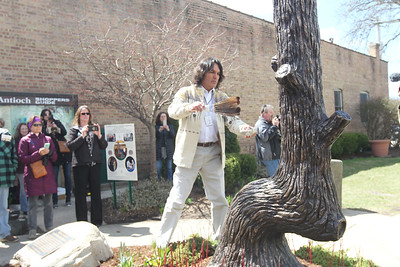Candace H. Johnson-For Shaw Media Andrew Johnson, of Hinsdale, Cherokee, President, Native American Chamber of Commerce of Illinois, uses the smoke from burning sage, tobacco, sweet grass and cedar (called smudging) to bless the Trail Marker Tree bronze sculpture during the Installation and Dedication of the sculpture on Main Street in Antioch.The sculpture, made by local artist, Dennis Downes, stands in a mini-park next to JJ Blinkers on Main Street.(4/28/18)