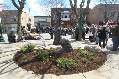 Candace H. Johnson-For Shaw Media Mayor Lawrence Hanson, with the Village of Antioch, talks to the crowd during the Trail Marker Tree bronze sculpture Installation and Dedication on Main Street in Antioch.The sculpture, made by local artist Dennis Downes, stands in a mini-park next to JJ Blinkers on Main Street.(4/28/18)