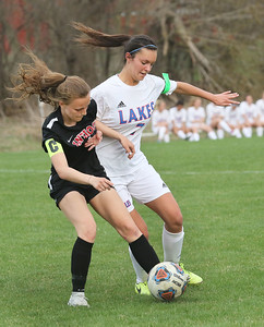 Candace H. Johnson-For Shaw Media Antioch's Ella Roberts battles for control with Lakes Alyssa Bombicino in the second half at Lakes Community High School in Lake Villa. (5/1/18) Antioch won 2-0.
