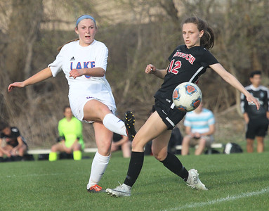 Candace H. Johnson-For Shaw Media Lakes Faith Conway passes the ball past Antioch's Ella Roberts in the second half at Lakes Community High School in Lake Villa. (5/1/18) Antioch won 2-0.