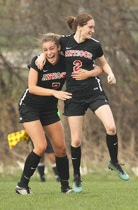 Candace H. Johnson-For Shaw Media Antioch's Gabby Michaels congratulates Rachel Moore on her goal against Lakes in the second half at Lakes Community High School in Lake Villa. (5/1/18) Antioch won 2-0.